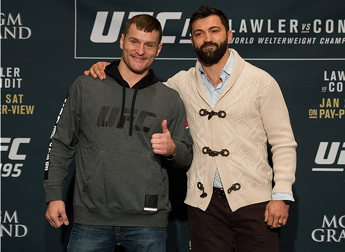 LAS VEGAS, NEVADA - DECEMBER 31:  (L-R) Stipe Miocic and Andrei Arlovski pose for a picture after facing off during the Ultimate Media Day at the MGM Grand Hotel/Casino on December 31, 2015 in Las Vegas Nevada. (Photo by Brandon Magnus/Zuffa LLC/Zuffa LLC