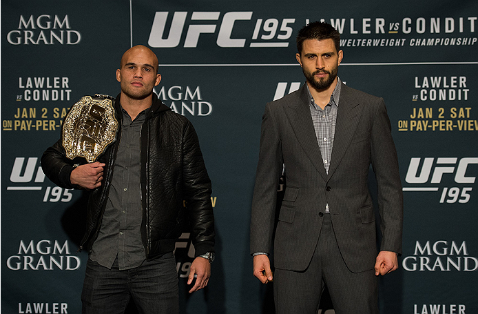 LAS VEGAS, NEVADA - DECEMBER 31:  (L-R) UFC welterweight champion Robbie Lawler and Carlos Condit pose for a picture after facing off during the Ultimate Media Day at the MGM Grand Hotel/Casino on December 31, 2015 in Las Vegas Nevada. (Photo by Brandon M