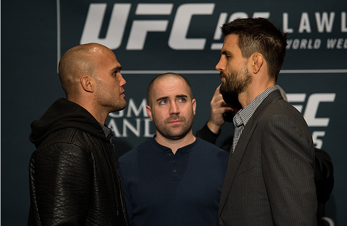 LAS VEGAS, NEVADA - DECEMBER 31:  (L-R) UFC welterweight champion Robbie Lawler and Carlos Condit face off during the Ultimate Media Day at the MGM Grand Hotel/Casino on December 31, 2015 in Las Vegas Nevada. (Photo by Brandon Magnus/Zuffa LLC/Zuffa LLC v