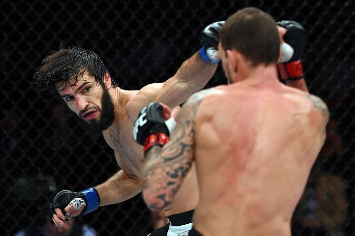 CURITIBA, BRAZIL - MAY 14:  (L-R) Zubaira Tukhugov of Russia punches Renato Moicano of Brazil in their featherweight bout during the UFC 198 event at Arena da Baixada stadium on May 14, 2016 in Curitiba, Parana, Brazil.  (Photo by Josh Hedges/Zuffa LLC/Zu
