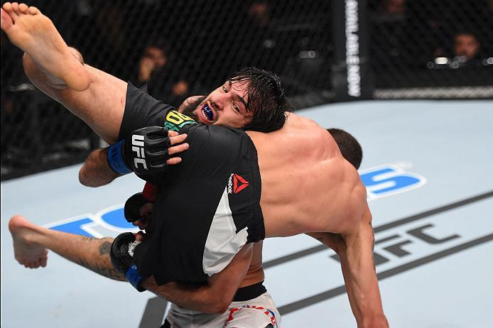 CURITIBA, BRAZIL - MAY 14:  (L-R) Zubaira Tukhugov of Russia takes down Renato Moicano of Brazil in their featherweight bout during the UFC 198 event at Arena da Baixada stadium on May 14, 2016 in Curitiba, Parana, Brazil.  (Photo by Josh Hedges/Zuffa LLC