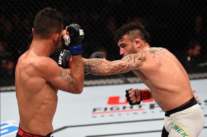 CURITIBA, BRAZIL - MAY 14:  (R-L) John Lineker of Brazil punches Rob Font in their bantamweight bout during the UFC 198 event at Arena da Baixada stadium on May 14, 2016 in Curitiba, Parana, Brazil.  (Photo by Josh Hedges/Zuffa LLC/Zuffa LLC via Getty Ima