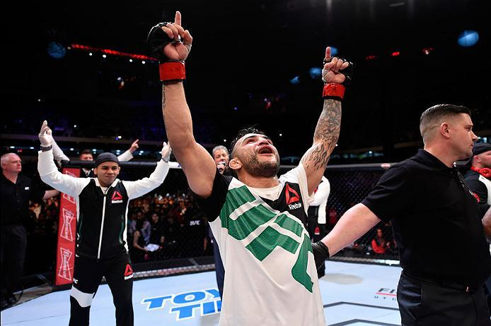 CURITIBA, BRAZIL - MAY 14:  John Lineker of Brazil celebrates after defeating Rob Font by unanimous decision in their bantamweight bout during the UFC 198 event at Arena da Baixada stadium on May 14, 2016 in Curitiba, Parana, Brazil.  (Photo by Josh Hedge