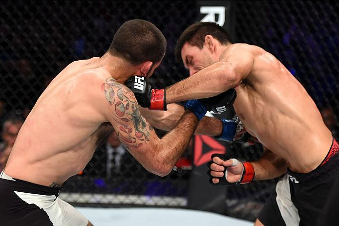 CURITIBA, BRAZIL - MAY 14:  (R-L) Demian Maia of Brazil punches Matt Brown in their welterweight bout during the UFC 198 event at Arena da Baixada stadium on May 14, 2016 in Curitiba, Parana, Brazil.  (Photo by Josh Hedges/Zuffa LLC/Zuffa LLC via Getty Im