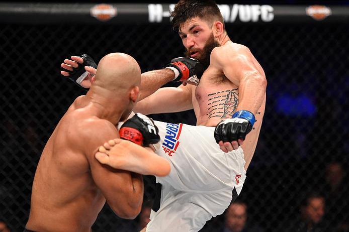 CURITIBA, BRAZIL - MAY 14:  (R-L) Bryan Barberena kicks Warlley Alves of Brazil in their middleweight bout during the UFC 198 event at Arena da Baixada stadium on May 14, 2016 in Curitiba, Parana, Brazil.  (Photo by Josh Hedges/Zuffa LLC/Zuffa LLC via Get