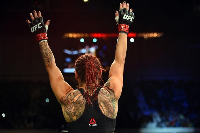 CURITIBA, BRAZIL - MAY 14:  Cristiane 'Cyborg' Justino of Brazil celebrates after defeating Leslie Smith in their women's catchweight bout during the UFC 198 event at Arena da Baixada stadium on May 14, 2016 in Curitiba, Parana, Brazil.  (Photo by Josh He