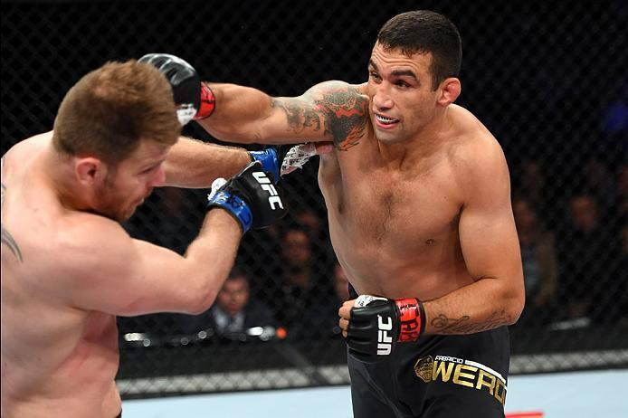 CURITIBA, BRAZIL - MAY 14:  (R-L) Fabricio Werdum of Brazil punches Stipe Miocic in their UFC heavyweight championship bout during the UFC 198 event at Arena da Baixada stadium on May 14, 2016 in Curitiba, Parana, Brazil.  (Photo by Josh Hedges/Zuffa LLC/