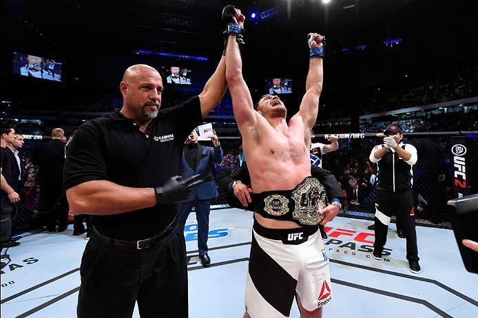 CURITIBA, BRAZIL - MAY 14:  Stipe Miocic celebrates after defeating Fabricio Werdum of Brazil by KO in their UFC heavyweight championship bout during the UFC 198 event at Arena da Baixada stadium on May 14, 2016 in Curitiba, Parana, Brazil.  (Photo by Jos