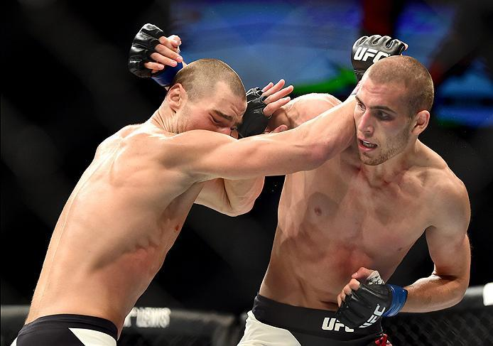 INGLEWOOD, CA - JUNE 04: Sean Strickland and Tom Breese of England exchange blows in their welterweight bout during the UFC 199 event at The Forum on June 4, 2016 in Inglewood, California.  (Photo by Harry How/Zuffa LLC/Zuffa LLC via Getty Images)