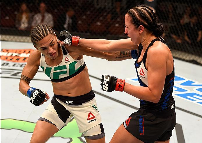 INGLEWOOD, CA - JUNE 04:  Jessica Andrade and Jessica Penne trade blows in their women's strawweight bout during the UFC 199 event at The Forum on June 4, 2016 in Inglewood, California.  (Photo by Josh Hedges/Zuffa LLC/Zuffa LLC via Getty Images)