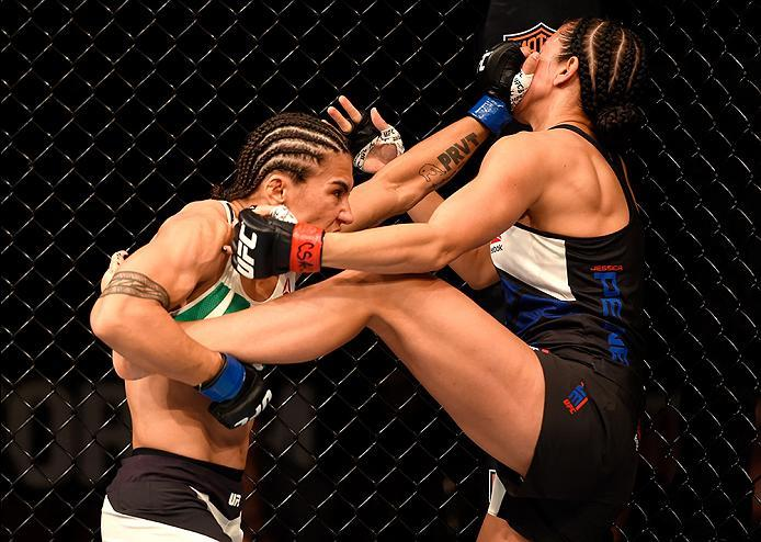 INGLEWOOD, CA - JUNE 04: Jessica Andrade of Brazil wrestles Jessica Penne in their women's strawweight bout during the UFC 199 event at The Forum on June 4, 2016 in Inglewood, California.  (Photo by Josh Hedges/Zuffa LLC/Zuffa LLC via Getty Images)