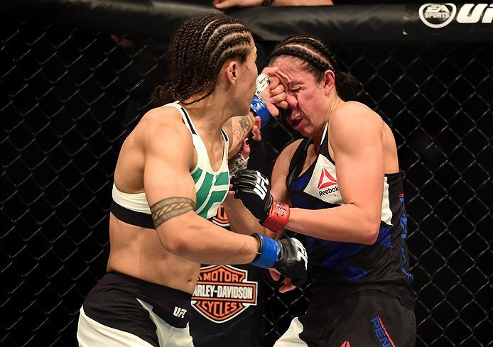 INGLEWOOD, CA - JUNE 04:  Jessica Andrade lands a left to the face of Jessica Penne in their women's strawweight bout during the UFC 199 event at The Forum on June 4, 2016 in Inglewood, California.  (Photo by Harry How/Zuffa LLC/Zuffa LLC via Getty Images