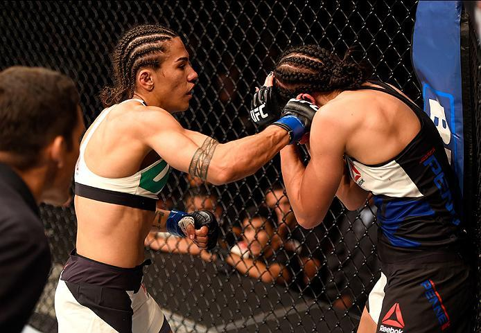 INGLEWOOD, CA - JUNE 04:  Jessica Andrade of Brazil punches Jessica Penne in their women's strawweight bout during the UFC 199 event at The Forum on June 4, 2016 in Inglewood, California.  (Photo by Josh Hedges/Zuffa LLC/Zuffa LLC via Getty Images)