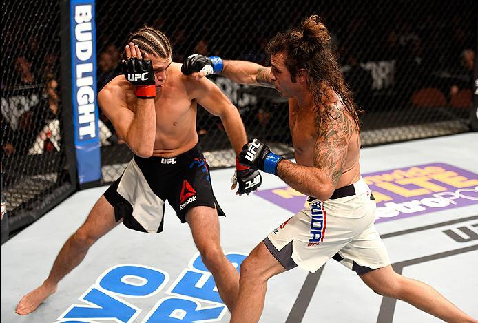 INGLEWOOD, CA - JUNE 04: Clay Guida punches Brian Ortega in their featherweight bout during the UFC 199 event at The Forum on June 4, 2016 in Inglewood, California.  (Photo by Josh Hedges/Zuffa LLC/Zuffa LLC via Getty Images)