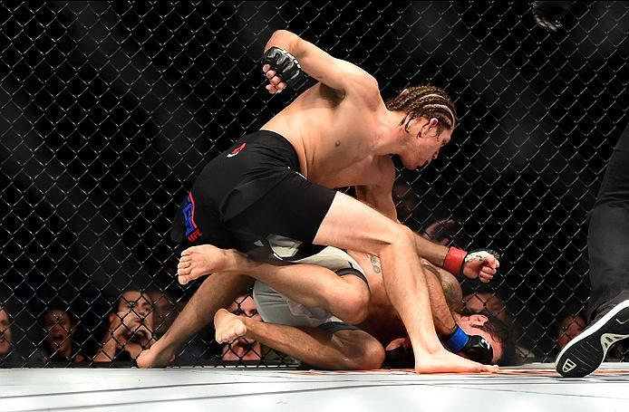 INGLEWOOD, CA - JUNE 04:  Brian Ortega punches Clay Guida in their featherweight bout during the UFC 199 event at The Forum on June 4, 2016 in Inglewood, California.  (Photo by Harry How/Zuffa LLC/Zuffa LLC via Getty Images)