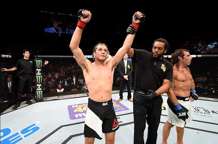 INGLEWOOD, CA - JUNE 04:  Brian Ortega celebrates after his TKO win in the third round against Clay Guida in their featherweight bout during the UFC 199 event at The Forum on June 4, 2016 in Inglewood, California.  (Photo by Josh Hedges/Zuffa LLC/Zuffa LL