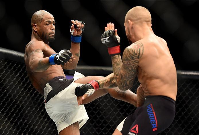 INGLEWOOD, CA - JUNE 04: Bobby Green kicks Dustin Poirier in their lightweight bout during the UFC 199 event at The Forum on June 4, 2016 in Inglewood, California.  (Photo by Harry How/Zuffa LLC/Zuffa LLC via Getty Images)