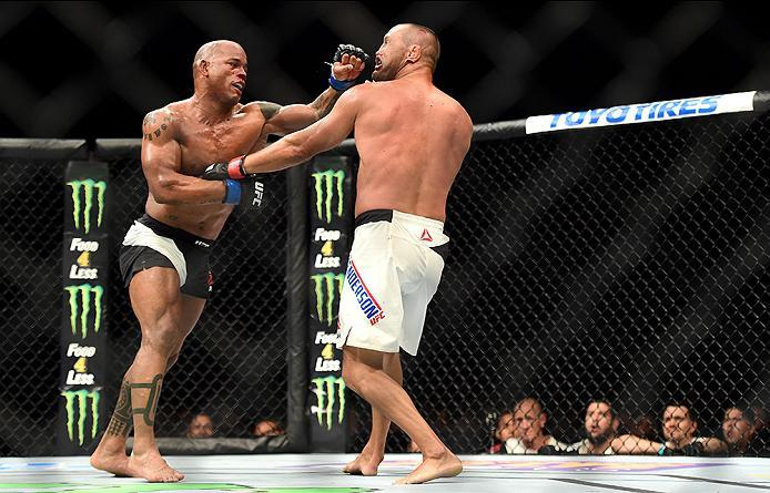 INGLEWOOD, CA - JUNE 04: Hector Lombard of Cuba punches Dan Henderson in their middleweight bout during the UFC 199 event at The Forum on June 4, 2016 in Inglewood, California.  (Photo by Harry How/Zuffa LLC/Zuffa LLC via Getty Images)