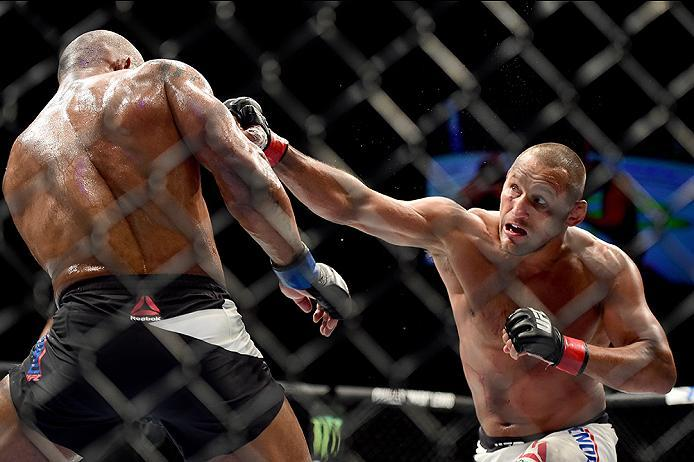 INGLEWOOD, CA - JUNE 04:  Dan Henderson punches Hector Lombard of Cuba in their middleweight bout during the UFC 199 event at The Forum on June 4, 2016 in Inglewood, California.  (Photo by Harry How/Zuffa LLC/Zuffa LLC via Getty Images)