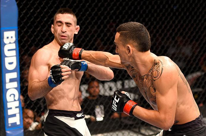 INGLEWOOD, CA - JUNE 04:  Max Holloway lands a right punch on Ricardo Lamas in their featherweight bout during the UFC 199 event at The Forum on June 4, 2016 in Inglewood, California.  (Photo by Josh Hedges/Zuffa LLC/Zuffa LLC via Getty Images)
