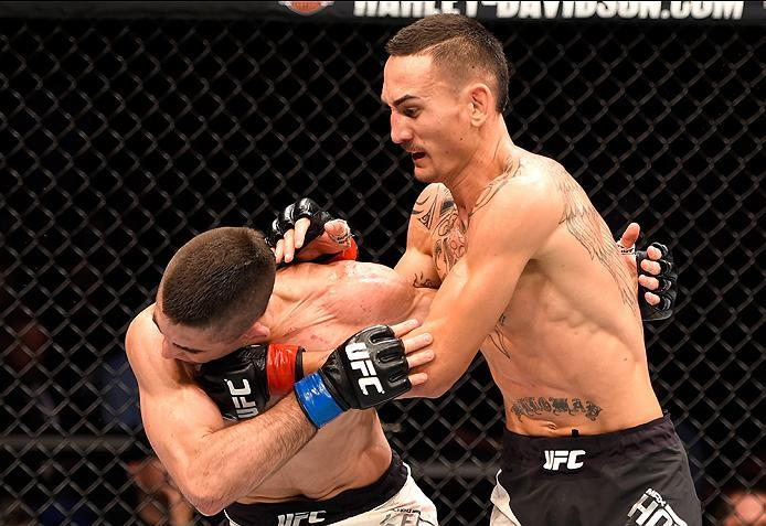 INGLEWOOD, CA - JUNE 04: Max Holloway punches Ricardo Lamas in their featherweight bout during the UFC 199 event at The Forum on June 4, 2016 in Inglewood, California.  (Photo by Josh Hedges/Zuffa LLC/Zuffa LLC via Getty Images)