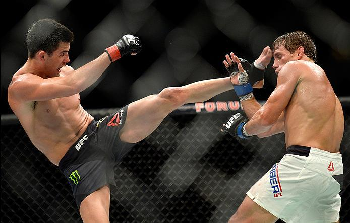 INGLEWOOD, CA - JUNE 04: Dominick Cruz kicks Urijah Faber during the UFC 199 event at The Forum on June 4, 2016 in Inglewood, California.  (Photo by Brandon Magnus/Zuffa LLC/Zuffa LLC via Getty Images)
