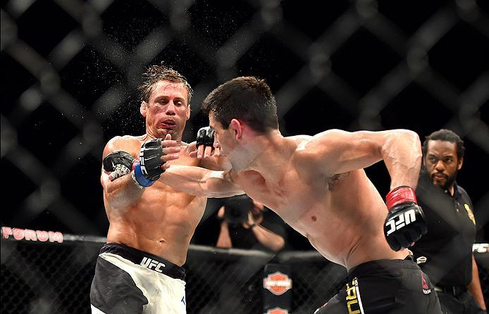 INGLEWOOD, CA - JUNE 04:  Dominick Cruz throws a right punch at Urijah Faber in their UFC bantamweight championship bout during the UFC 199 event at The Forum on June 4, 2016 in Inglewood, California.  (Photo by Harry How/Zuffa LLC/Zuffa LLC via Getty Ima