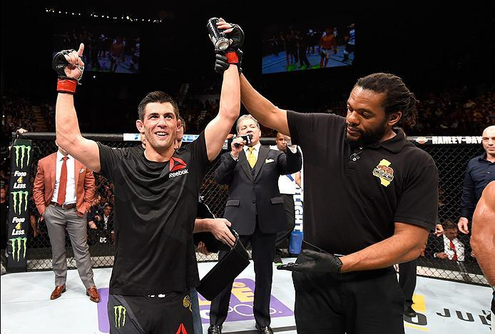 INGLEWOOD, CA - JUNE 04: Dominick Cruz  celebrates after defeating Urijah Faber by unanimous decision in their UFC bantamweight championship bout during the UFC 199 event at The Forum on June 4, 2016 in Inglewood, California.  (Photo by Josh Hedges/Zuffa