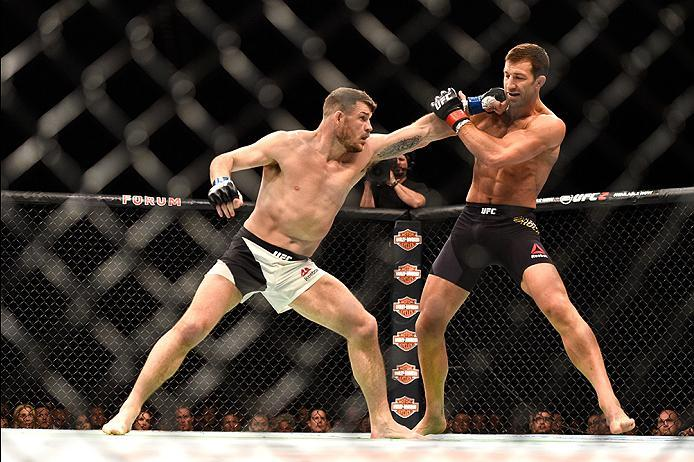 INGLEWOOD, CA - JUNE 04: Michael Bisping of England throws a left at Luke Rockhold during the UFC 199 event at The Forum on June 4, 2016 in Inglewood, California.  (Photo by Jeff Bottari/Zuffa LLC/Zuffa LLC via Getty Images)