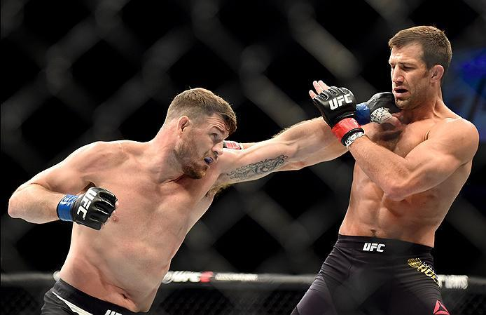 INGLEWOOD, CA - JUNE 04: Michael Bisping of England throws a left punch at Luke Rockhold in their UFC middleweight championship bout during the UFC 199 event at The Forum on June 4, 2016 in Inglewood, California.  (Photo by Harry How/Zuffa LLC/Zuffa LLC v