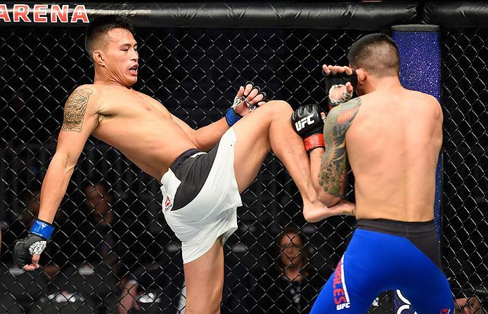 LAS VEGAS, NV - MARCH 04: (L-R) Andre Soukhamthath knees Albert Morales in their bantamweight bout during the UFC 209 event at T-Mobile Arena on March 4, 2017 in Las Vegas, Nevada.  (Photo by Josh Hedges/Zuffa LLC/Zuffa LLC via Getty Images) *** Local Cap