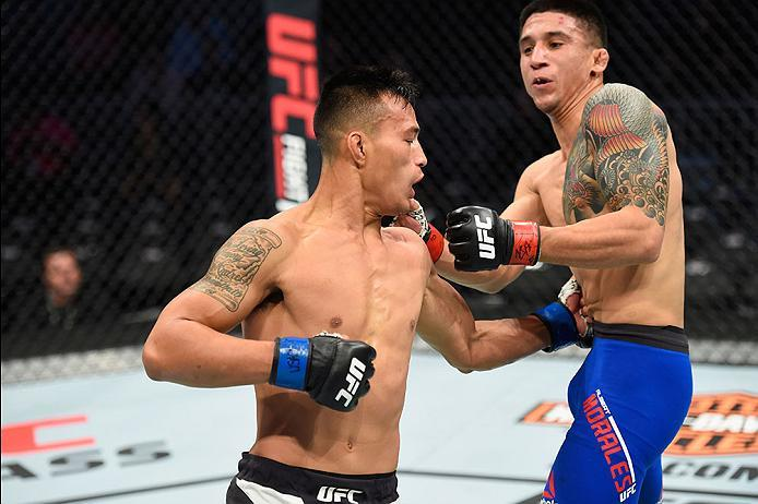 LAS VEGAS, NV - MARCH 04: (L-R) Andre Soukhamthath punches Albert Morales in their bantamweight bout during the UFC 209 event at T-Mobile Arena on March 4, 2017 in Las Vegas, Nevada.  (Photo by Josh Hedges/Zuffa LLC/Zuffa LLC via Getty Images) *** Local C