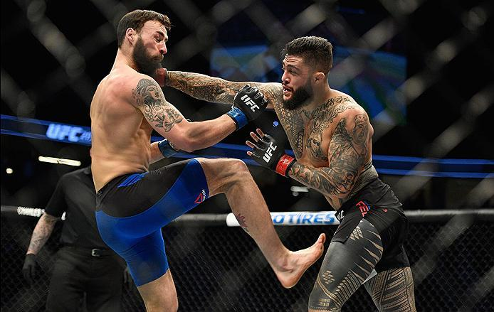 LAS VEGAS, NV - MARCH 04: (R-L) Tyson Pedro of Australia punches Paul Craig of Scotland in their light heavyweight bout during the UFC 209 event at T-Mobile Arena on March 4, 2017 in Las Vegas, Nevada.  (Photo by Jeff Bottari/Zuffa LLC/Zuffa LLC via Getty
