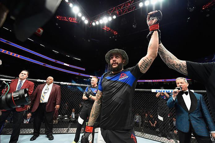 LAS VEGAS, NV - MARCH 04: Tyson Pedro of Australia reacts to his victor over Paul Craig of Scotland in their light heavyweight bout during the UFC 209 event at T-Mobile Arena on March 4, 2017 in Las Vegas, Nevada.  (Photo by Josh Hedges/Zuffa LLC/Zuffa LL