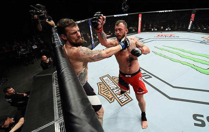LAS VEGAS, NV - MARCH 04: (R-L) Mark Godbeer of England punches Daniel Spitz in their heavyweight bout during the UFC 209 event at T-Mobile Arena on March 4, 2017 in Las Vegas, Nevada.  (Photo by Josh Hedges/Zuffa LLC/Zuffa LLC via Getty Images) *** Local