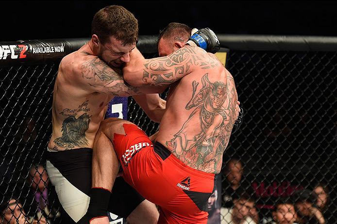 LAS VEGAS, NV - MARCH 04: (R-L) Mark Godbeer of England knees Daniel Spitz in their heavyweight bout during the UFC 209 event at T-Mobile Arena on March 4, 2017 in Las Vegas, Nevada.  (Photo by Josh Hedges/Zuffa LLC/Zuffa LLC via Getty Images) *** Local C