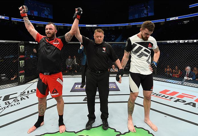 LAS VEGAS, NV - MARCH 04: (L-R) Mark Godbeer of England reacts to his victory over Daniel Spitz in their heavyweight bout during the UFC 209 event at T-Mobile Arena on March 4, 2017 in Las Vegas, Nevada.  (Photo by Josh Hedges/Zuffa LLC/Zuffa LLC via Gett