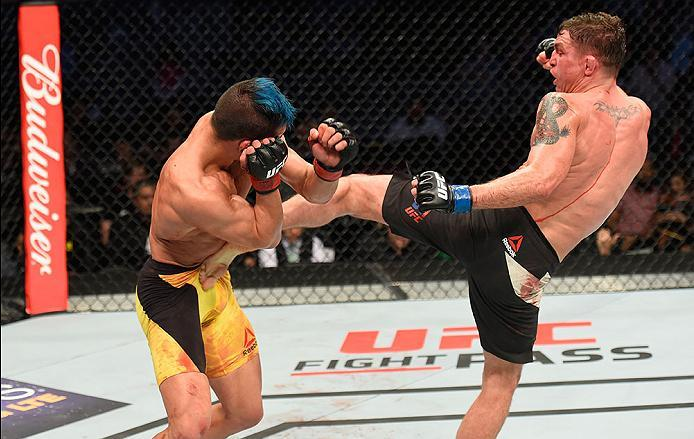 LAS VEGAS, NV - MARCH 04: (R-L) Darren Elkins kicks Mirsad Bektic of Bosnia in their featherweight bout during the UFC 209 event at T-Mobile Arena on March 4, 2017 in Las Vegas, Nevada.  (Photo by Josh Hedges/Zuffa LLC/Zuffa LLC via Getty Images) *** Loca