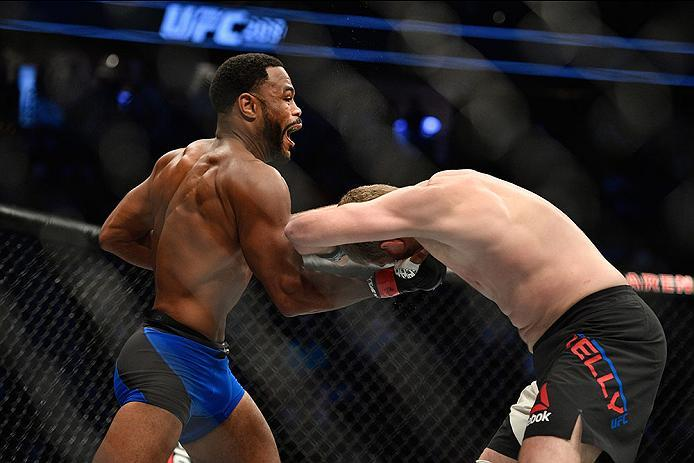 LAS VEGAS, NV - MARCH 04: (L-R) Rashad Evans punches Daniel Kelly of Australia in their middleweight bout during the UFC 209 event at T-Mobile Arena on March 4, 2017 in Las Vegas, Nevada.  (Photo by Jeff Bottari/Zuffa LLC/Zuffa LLC via Getty Images) *** L
