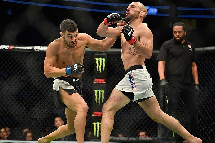LAS VEGAS, NV - MARCH 04: (L-R) David Teymur of Sweden punches Lando Vannata in their lightweight bout during the UFC 209 event at T-Mobile Arena on March 4, 2017 in Las Vegas, Nevada.  (Photo by Jeff Bottari/Zuffa LLC/Zuffa LLC via Getty Images) *** Loca