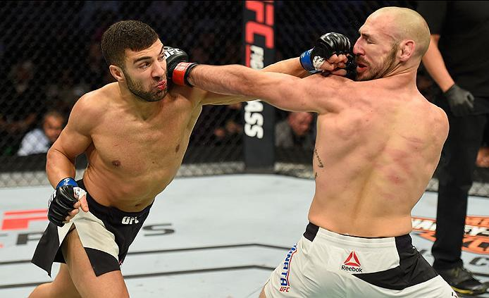 LAS VEGAS, NV - MARCH 04: (L-R) David Teymur of Sweden punches Lando Vannata in their lightweight bout during the UFC 209 event at T-Mobile Arena on March 4, 2017 in Las Vegas, Nevada.  (Photo by Josh Hedges/Zuffa LLC/Zuffa LLC via Getty Images) *** Local