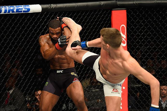 LAS VEGAS, NV - MARCH 04: (R-L) Stephen Thompson kicks Tyron Woodley in their UFC welterweight championship bout during the UFC 209 event at T-Mobile Arena on March 4, 2017 in Las Vegas, Nevada.  (Photo by Josh Hedges/Zuffa LLC/Zuffa LLC via Getty Images)