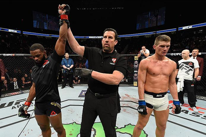 LAS VEGAS, NV - MARCH 04: Tyron Woodley (left) reacts to his victory over Stephen Thompson (right) in their UFC welterweight championship bout during the UFC 209 event at T-Mobile Arena on March 4, 2017 in Las Vegas, Nevada.  (Photo by Josh Hedges/Zuffa L