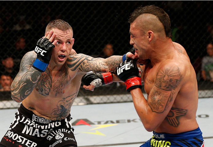 ALBUQUERQUE, NM - JUNE 07:  (L-R) Ross Pearson punches Diego Sanchez in their lightweight fight during the UFC Fight Night event at Tingley Coliseum on June 7, 2014 in Albuquerque, New Mexico.  (Photo by Josh Hedges/Zuffa LLC/Zuffa LLC via Getty Images)