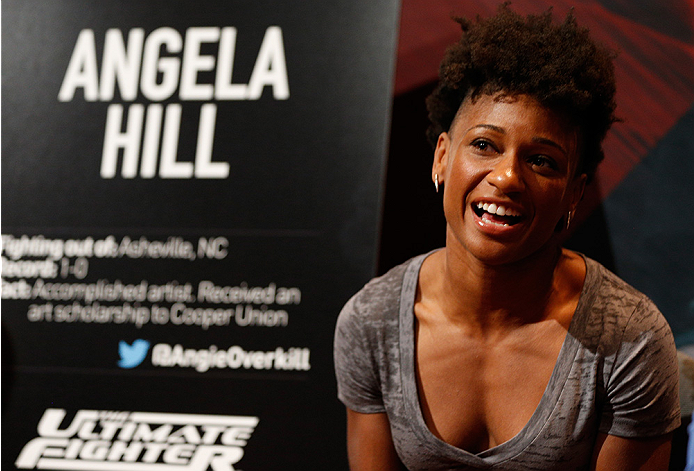 LAS VEGAS, NV - JULY 03:  The Ultimate Fighter season 20 cast member Angela Hill interacts with media during the UFC Ultimate Media Day at the Mandalay Bay Resort and Casino on July 3, 2014 in Las Vegas, Nevada.  (Photo by Josh Hedges/Zuffa LLC/Zuffa LLC