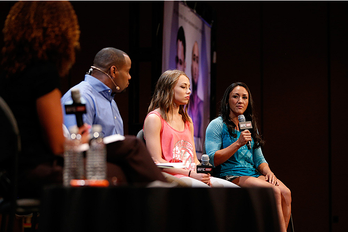 LAS VEGAS, NV - JULY 03:  (R-L) The Ultimate Fighter season 20 cast members Carla Esparza and Rose Namajunas interact with fans during the UFC Ultimate Media Day at the Mandalay Bay Resort and Casino on July 3, 2014 in Las Vegas, Nevada.  (Photo by Josh H