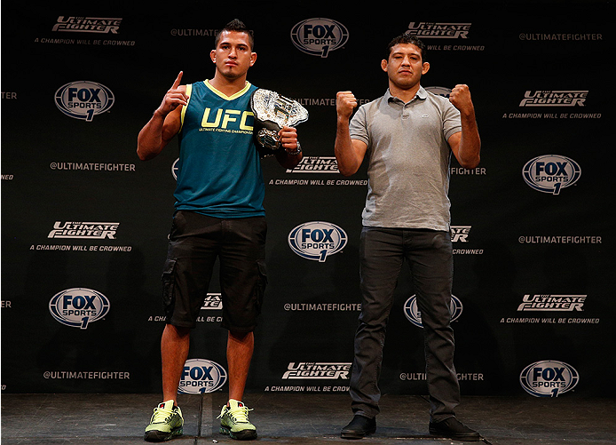 LAS VEGAS, NV - JULY 03:  (L-R) UFC lightweight champion Anthony Pettis and upcoming opponent Gilbert Melendez pose for photos during the UFC Ultimate Media Day at the Mandalay Bay Resort and Casino on July 3, 2014 in Las Vegas, Nevada.  (Photo by Josh He