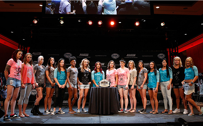 LAS VEGAS, NV - JULY 03:  A general view of the entire cast of The Ultimate Fighter season 20 is seen on stage with the UFC strawweight title belt during the UFC Ultimate Media Day at the Mandalay Bay Resort and Casino on July 3, 2014 in Las Vegas, Nevada