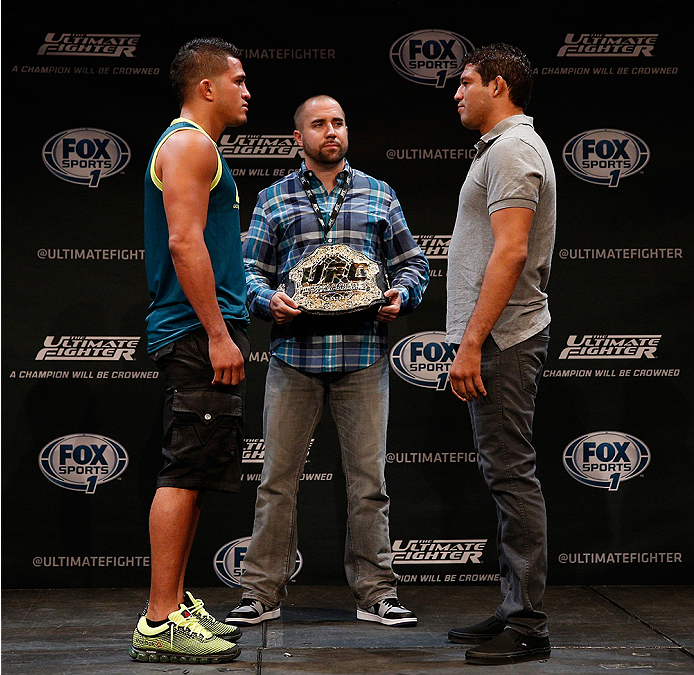 LAS VEGAS, NV - JULY 03:  (L-R) UFC lightweight champion Anthony Pettis and upcoming opponent Gilbert Melendez face off during the UFC Ultimate Media Day at the Mandalay Bay Resort and Casino on July 3, 2014 in Las Vegas, Nevada.  (Photo by Josh Hedges/Zu