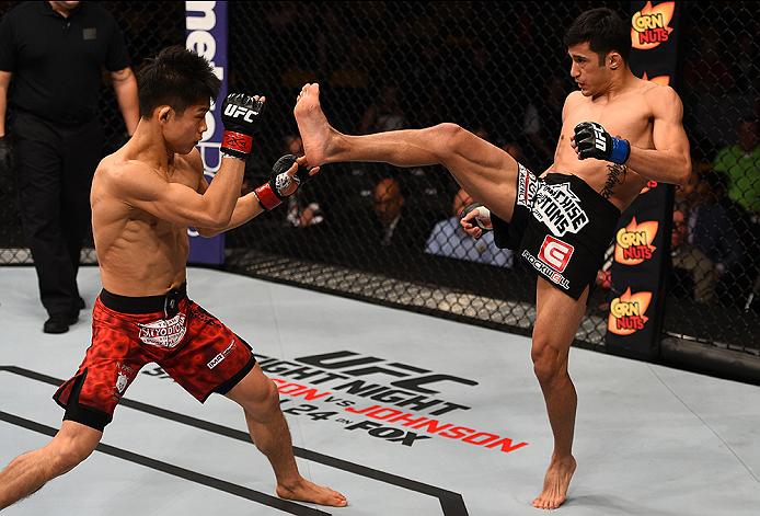 BOSTON, MA - JANUARY 18:  (R-L) Joby Sanchez kicks Tateki Matsuda in their flyweight fight during the UFC Fight Night event at the TD Garden on January 18, 2015 in Boston, Massachusetts. (Photo by Jeff Bottari/Zuffa LLC/Zuffa LLC via Getty Images)